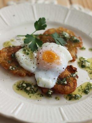 Tostones eggs Benedict with cilantro sauce