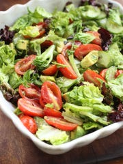 Make a simple tossed salad for a light summer entree.
