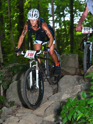Corrine Banks competes in the Xterra East Championship, which was also the International Triathlon Union nationals for off-road triathlon in June 2014.