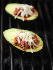Grill chili-stuffed avocados.