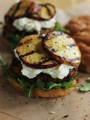 Turkey burgers with goat cheese and grilled peaches are a healthier way to enjoy a burger.