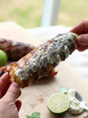 This June 8 photo shows bacon wrapped corn on the cob in Concord, N.H. This dish is from a recipe by Bryan Volaggio.