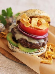 California Dreaming Burger touts Monterey Jack cheese, sliced avocado or guacamole, sliced tomato, sliced red onion and crunchy tortilla chips.