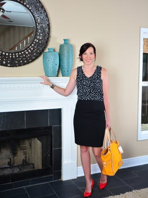 Stacy Snowden, Pencil skirt and polka-dot top, Nine West patent-leather pumps, and Dooney & Burke handbag.