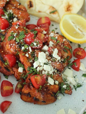 rilled gochujang chicken thighs with feta and fresh mint. The gochujang has kick, but doesn't overwhelm, being both salty and savory with a touch of sweetness.