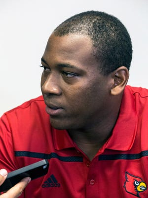 UofL defensive line coach L.D. Scott fields questions from reporters during Media Day at Papa John's Stadium on Saturday morning. 8/8/15