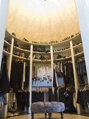 Abby's walk-in closet has a center spiral that revolves around a private dressing room.