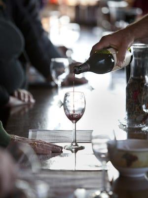 Guests at the Keuka Springs Vineyard enjoy wine samples as part of a Keuka Lake Wine Trail holiday event.