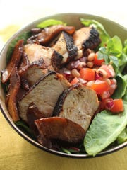 Stampede pork chops with black eyed peas and caramelized apples can be a 30 minute meal for dinner.
