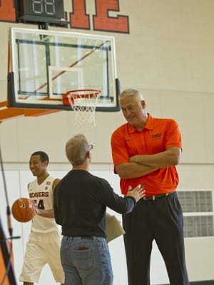 Statesman Journal reporter Gary Horowitz (left) interviews Oregon State men's basketball coach Wayne Tinkle.