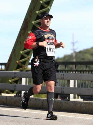 Wappingers Falls' Christopher Regan takes part in the Wineglass Marathon in Corning.