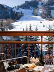 A romantic dinner on the balcony at The Little Nell in Aspen, Colorado.