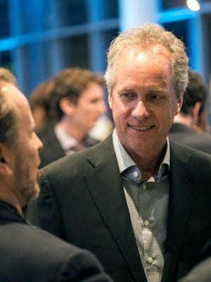 Louisville Mayor Greg Fischer chats with Speed Art Museum CEO Ghislain d'Humieres during a sneak peek party in some of the newly renovated spaces on Saturday night. Nov. 7, 2015
