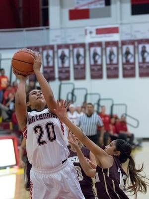 Centennial's Jasmyne Garcia goes up for the basket against Gadsden defenders.