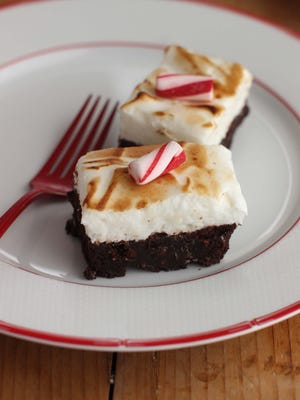 This Sept. 11, 2015 photo shows mini toasted marshmallow brownies in Concord, N.H. These cookies are from a recipe by Alison Ladman. (AP Photo/Matthew Mead)