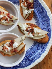 Goat Cheese and Pear Crostini is sprinkled with crumbled bacon.