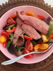 Lean roast beef tops a salad.
