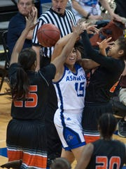 UNCA's Sonora Dengokl is guarded by a pair of Campbell defenders in the second period time out while battling Campbell University Friday afternoon during Big South Conference Tournament play at Kimmel Arena.