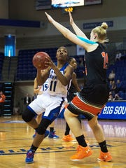 UNCA's Khalia Webb drives against Amanda Coffer of Campbell in the first period time out while battling Campbell University Friday afternoon during Big South Conference Tournament play at Kimmel Arena.
