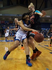 UNCA's Sonora Dengokl drives against Amanda Coffer of Campbell in the first period time out while battling Campbell University Friday afternoon during Big South Conference Tournament play at Kimmel Arena.