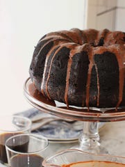 Chocolate Guinness cake is topped with chocolate Guinness glaze. The glaze is an essential part of the cake, as you poke holes in the cake when it is still warm and slowly spoon the glaze over the cake until the holes are filled with it.