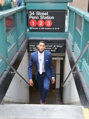 Denzel Valentine walks out of the New York subway during a promotion video for Macy's ahead of Thursday's NBA Draft. Macy's is his first endorsement contract.