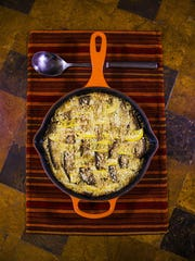 Skillet lasagne with pesto-spiced ricotta and pine nut crumble.
