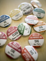 A sampling of the hundreds of gender pronoun pins distributed to Champlain College students, on Monday, August 29, 2016.