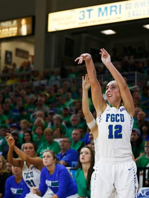 With under 2:30 to play Florida Gulf Coast guard Stephanie Haas (12) hits a pivotal three pointer that helped the start of securing the win during the second half Thursday, March 31, 2016 at Alico Arena in Fort Myers, Fla. Florida Gulf Coast faced Michigan in the semifinal round of the WNIT. Florida Gulf Coast won 71-62.