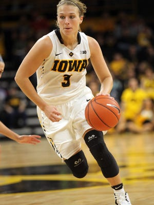 Iowa's Makenzie Meyer takes the ball down court during the Hawkeyes' game against Oral Roberts at Carver-Hawkeye Arena on Friday, Nov. 11, 2016.