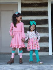 Families of Ellianna Maneage, left, and Kinley Galbierz,