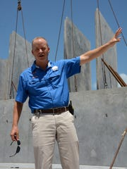 Rose Marina general manager Dan High shows the storm-proof building beginning to take shape. The marina is rebuilding their boat storage facility in a $7 million renovation project.