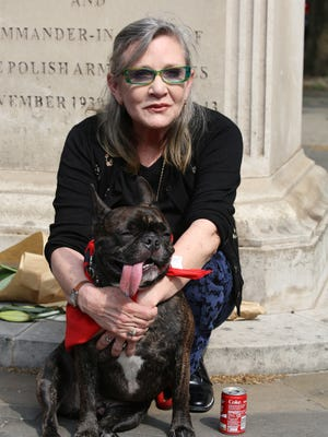 Carrie Fisher and her therapy dog Gary were inseparable.