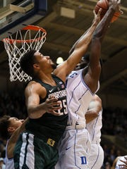 MSU's Kenny Goins battles for a rebound with Duke's