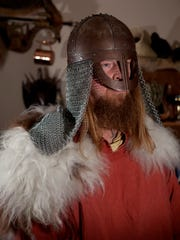 Tim McCumber poses for a portrait in one of his Viking