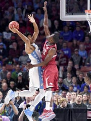 UNC forward Isaiah Hicks (4) goes up for a shot against Arkansas forward Moses Kingsley (33) during the 2nd round of the NCAA Tournament at Bon Secours Wellness Arena in downtown Greenville on Sunday, March 19, 2017.