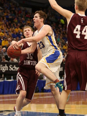 Michael Schaefer drives to the basket during the state Class 2-A semifinal game Friday, March 24, at the Target Center in Minneapolis.