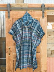 An Orenda Tribe nomad-hooded tunic made from Guatemalan handwoven plaid.