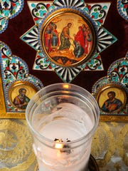 The Holy Fire candle at Christ the Saviour Antiochian Orthodox Church in Anderson inside the church. Father Randolph said the flame was originally from Israel and transported to New York, then to Anderson.