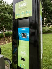 An information kiosk directs users through the process
