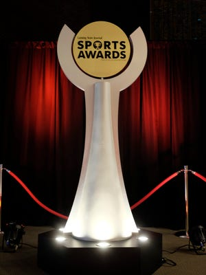 Student athletes, their friends and families get their photos taken as they arrive at the 2017 LSJ Sports Awards May 31.