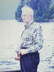 Herbert Baird on the dock at Fourth Lake.