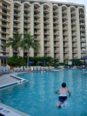 In this file photo, guests splash and relax poolside at the Marco Island Hilton May 26, 2015. Lance Shearer/Eagle Correspondent