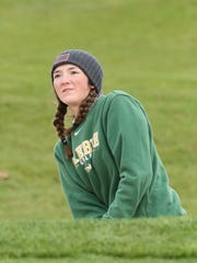 Green Bay Preble's Rachael Revolinksi looks at the ball she hit out of the sand trap in the second round of the WIAA Division 1 state girls golf tournament Tuesday at University Ridge Golf Course in Verona.
