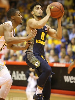 Marquette's Markus Howard drives the ball against VCU guard Malik Crowfield on Monday.