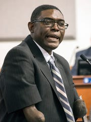 Vitalis Lanshima speaks to the Louisville Metro Council