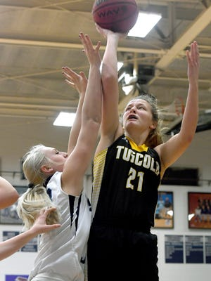 Tuscola's Shelby Glance goes up for a shot against Enka's Mya Smith during their game at Enka High School on Friday, Jan. 12, 2018. The Mountaineers defeated the Sugar Jets 66-58.
