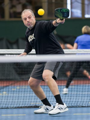 Pickleball fan Mike Azarian of Old Tappan plays at the Fair Lawn Racquet Club last month.