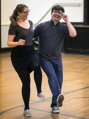 Jessica Marsh and Chris Schoenfelder enjoy a few laughs together during a Tuesday night swing dance class at Highlands Community Ministries. 1/30/18
