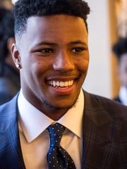 Penn State running back Saquon Barkley greeted fans